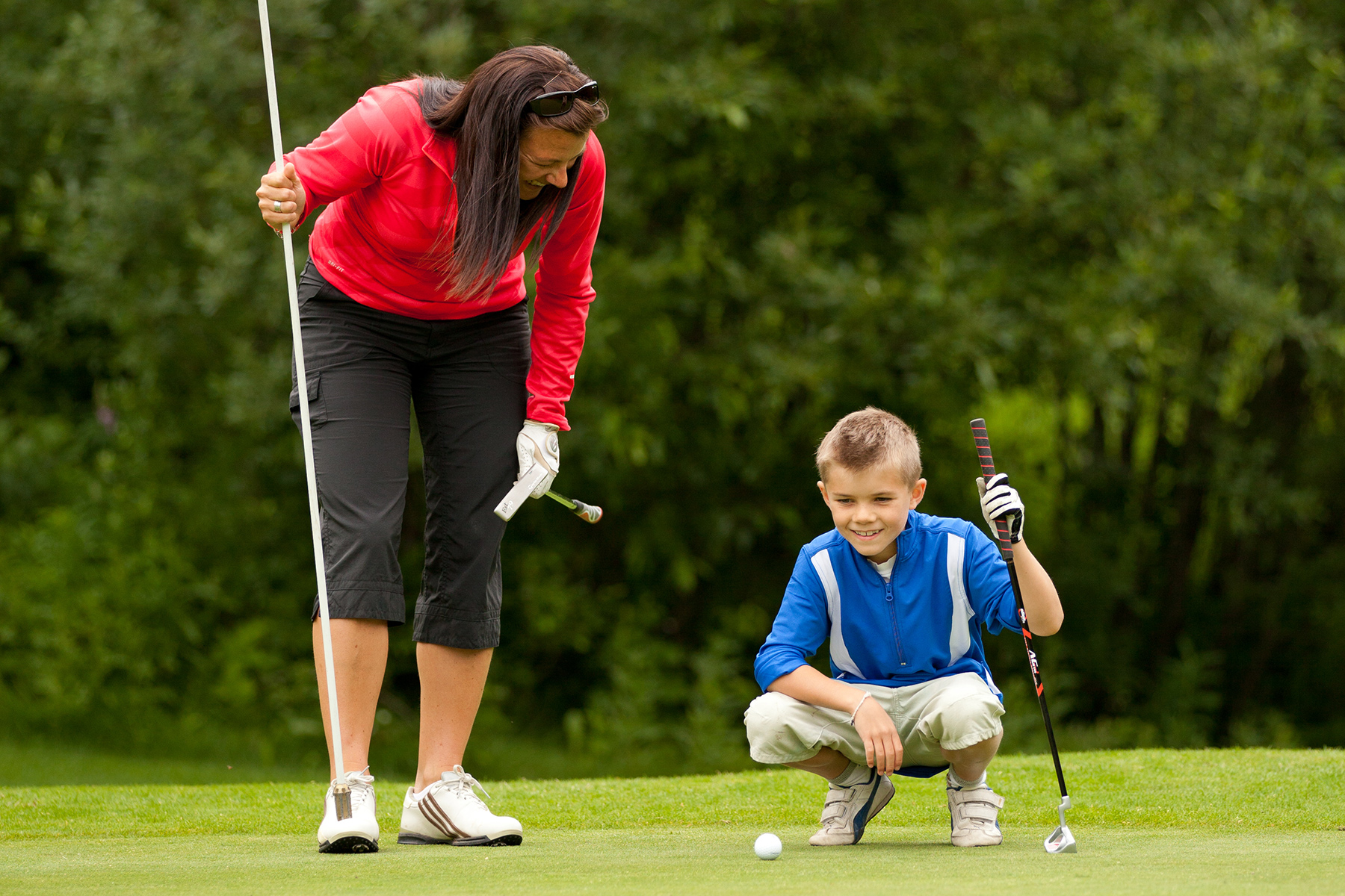 Child Playing Golf at Sun Peaks Resort