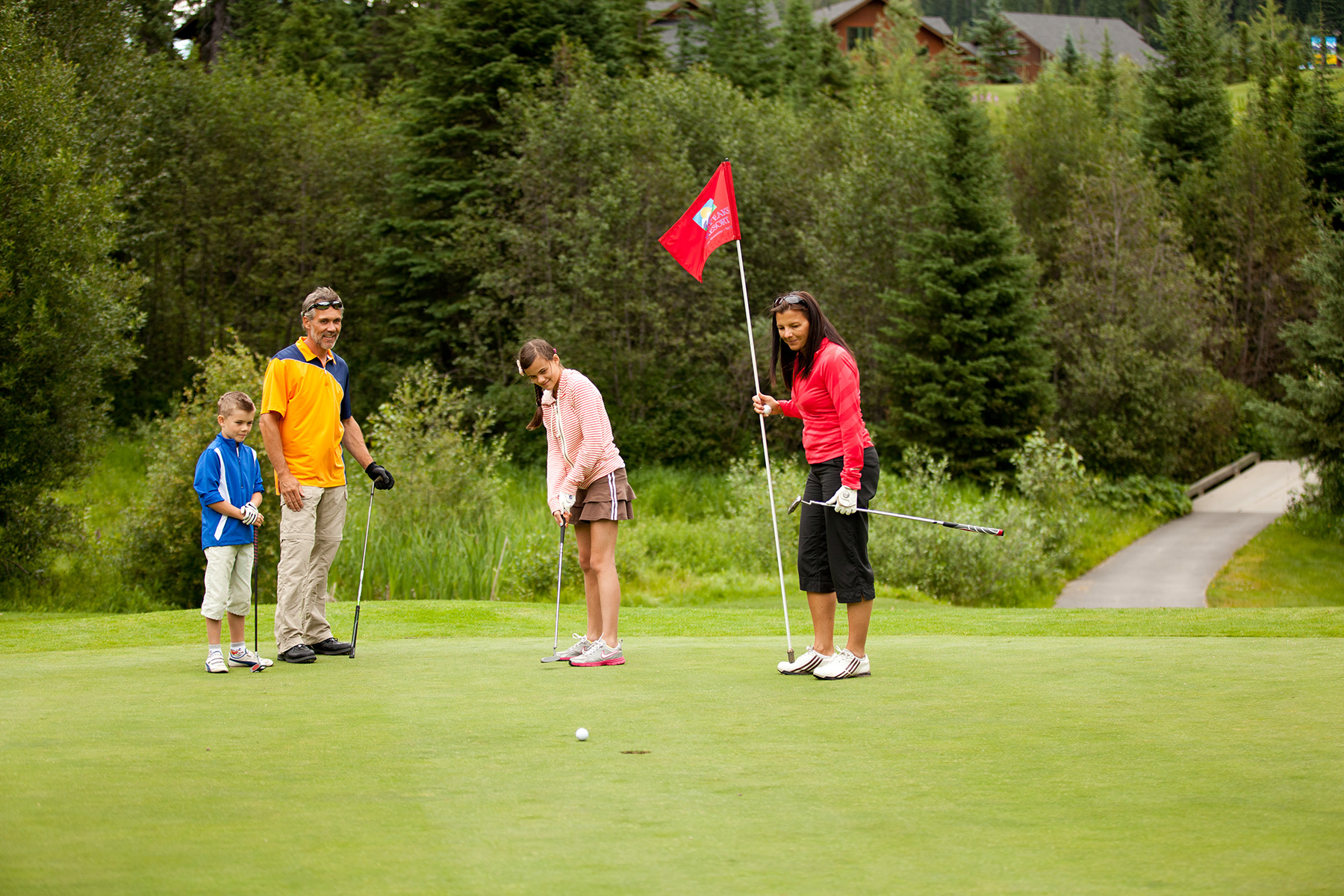 Family Playing Golf at Sun Peaks Resort