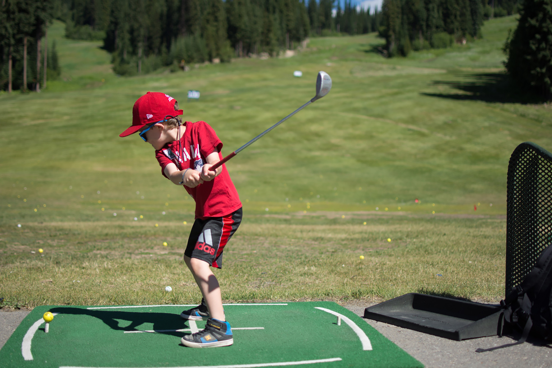 Child at Driving Range in Sun Peaks