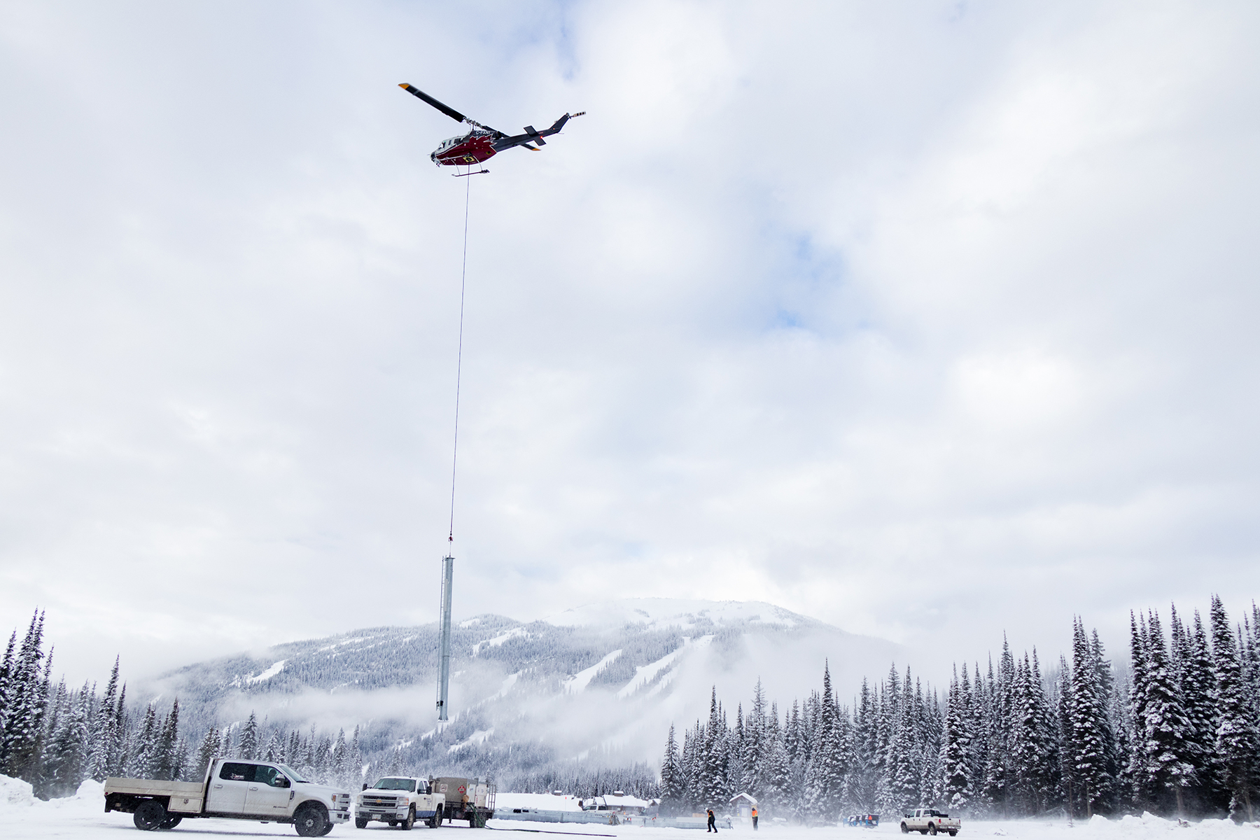 Heli Flying a Lift Tower in Sun Peaks