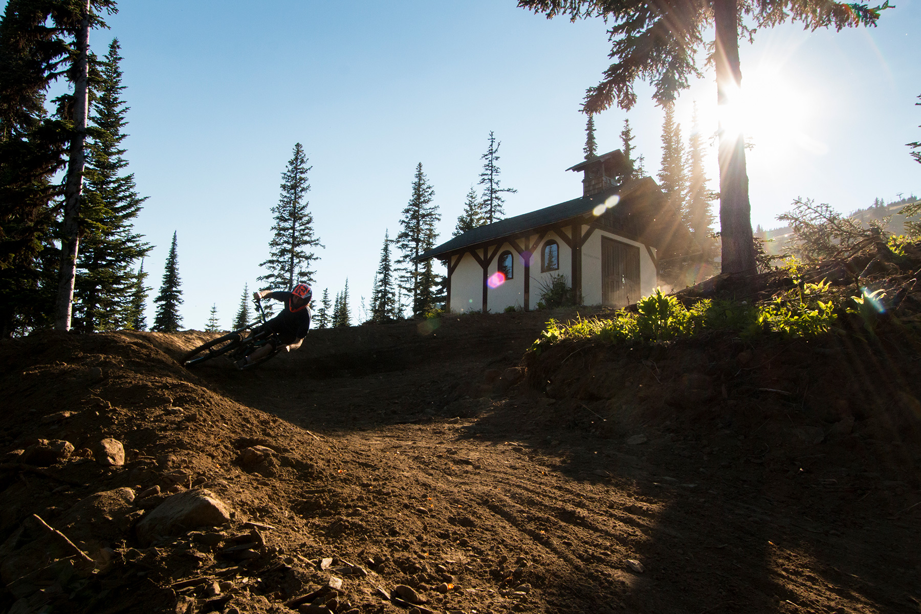 Rider on Route 66 at Sun Peaks Bike Park during sunset.
