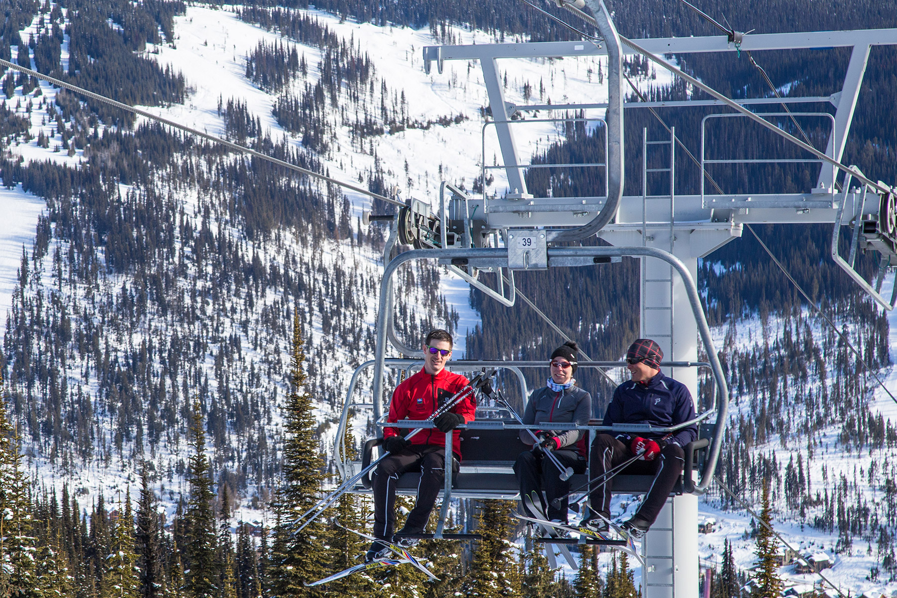Nordic skiers riding the Morrisey chairlift